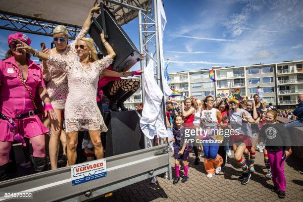 People attend the Pride at the Beach parade in the city centre of Zandvoort on July 31 2017 It is the first time the event which is part of Pride...