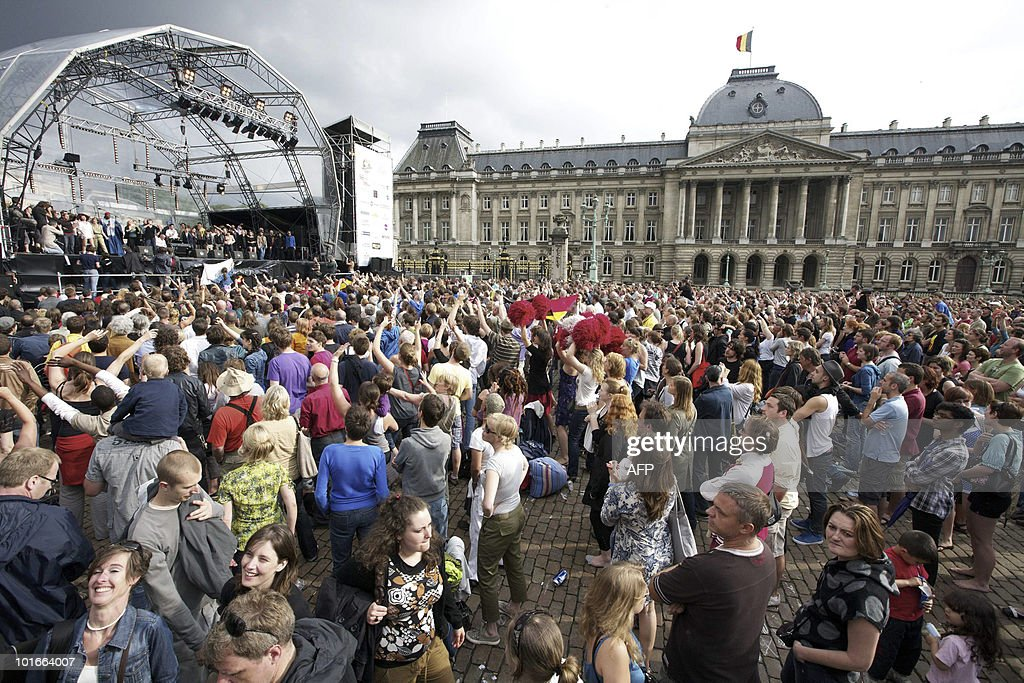 People attend the second Belgavox concert, a concert aimed to reinforce solidarity, dialogue, respect, community and cultural diversity in Belgium, with many Belgian artists attending, at the Paleizenplein - Place des Palais, in front of the Royal Palace in Brussels, on June 6, 2010. On June 13, 2010, Belgium will be holding its general elections.