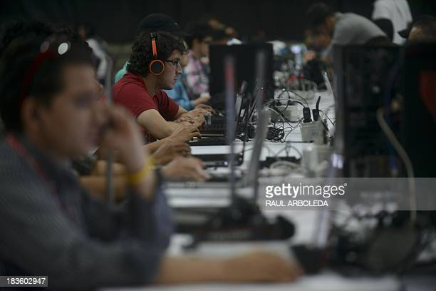 People attend the sixth edition of Colombia's Campus Party on October 7 in Medellin Antioquia department Colombia The Campus Party is considered the...