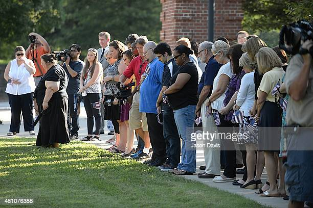 People attend the University of Tennessee Chattanooga Student Veteran's Organization Vigil for the Four Marines Killed on July 17 2015 in Chattanooga...