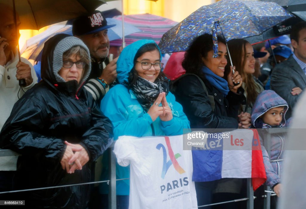 People attend the unveiling of the Olympic rings on the esplanade of Trocadero in front of the Eiffel tower after the official announcement of the attribution of the Olympic Games 2024 to the city of Paris on September 13, 2017 in Paris, France. For the first time in history, the International Olympic Committee (IOC) confirms two summer Games host cities at the same time, Paris will host the Olympic Games in 2024 and Los Angeles in 2028.