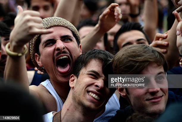 People attend the worker's day concert on May Day in Rome's Piazza San Giovanni on May 1 2012 AFP PHOTO / Filippo MONTEFORTE
