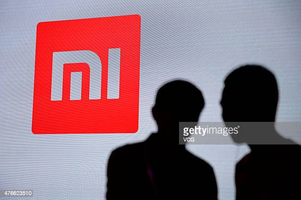 People attend Xiaomi's news conference at Crown Plaza Hotel on June 10 2015 in Beijing China Chinese tech company Xiaomi launched a new router today