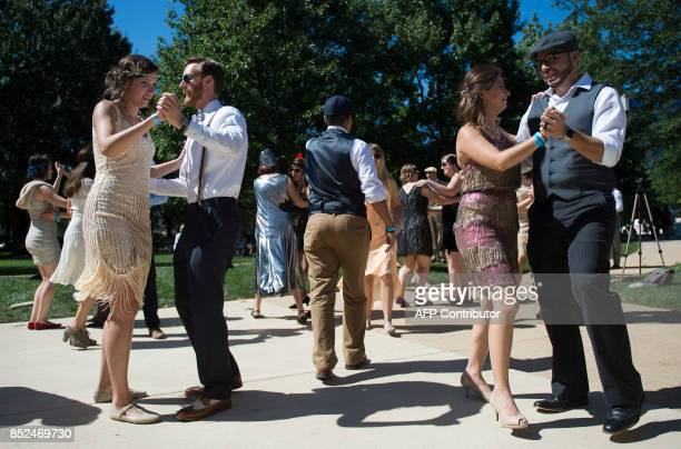 People attending Dardanella a Great Gatsby Lawn party dance in front of the National Cathedral in Washington DC on September 23 2017 'Dardanella'...