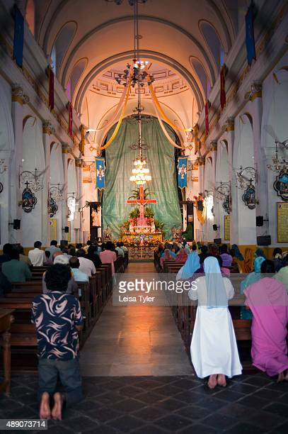 PONDICHERRY PUDUCHERRY INDIA People attending mass at the Cathedral of Our Lady of the Immaculate Conception first built in 1692 and completed in...