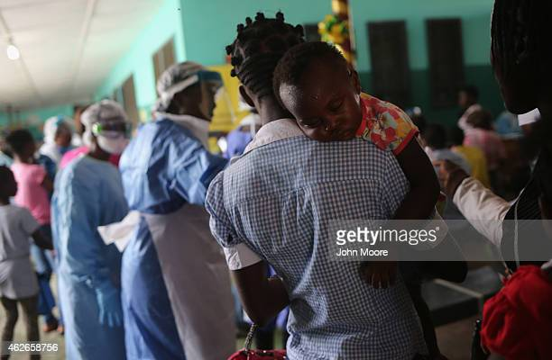 People await treatment in the outpatient lounge of Redemption Hospital formerly an Ebola holding center on February 2 2015 in Monrovia Liberia Most...