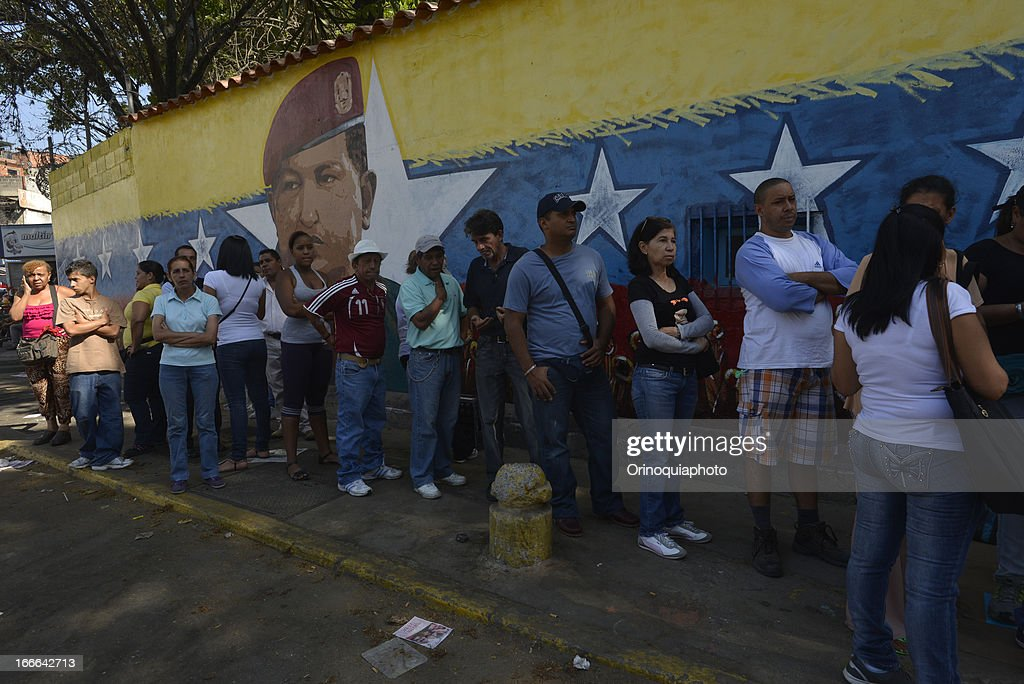 People awaits at voting centers to participate in venezuelan presidential elections on April 14, 2013 in Caracas, Venezuela. Nicolas Maduro, political heir of the late Venezuelan President Hugo Chavez, competes with opposition candidate Henrique Capriles.
