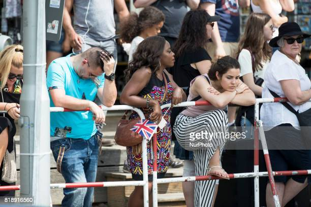 People awaits for the arrival of Britain's Prince William Duke of Cambridge and his wife Kate the Duchess of Cambridge at the Holocaust Memorial in...