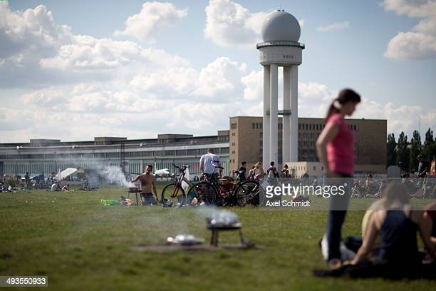 People barbecue in the park Tempelhofer Feld on May 24 2014 in Berlin Germany The city is planning to allow development for the construction of new...