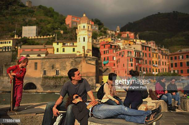 People bask in the afternoon sun on Sunday May 19 2013 in Vernazza Italy The area experienced significant damage from a 2011 flood