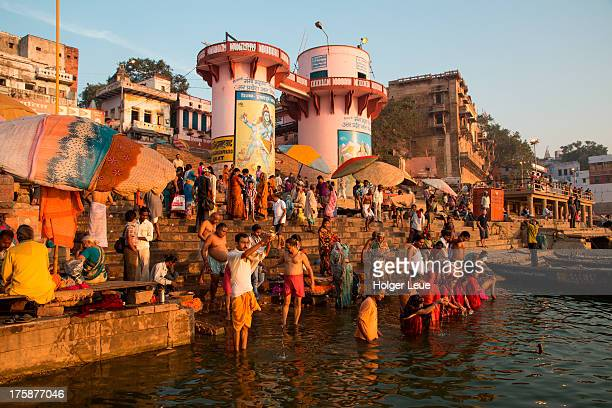 People bathe and pray in water of Ganges river
