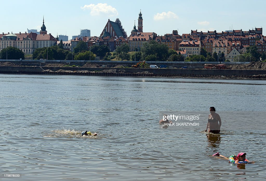 People bathe in the Wisla river in Warsaw, Poland on August 6, 2013. Thirty-five people have drowned in Poland since the beginning of August, according to police, as Poles attempt to combat a heatwave by flocking to the beach.