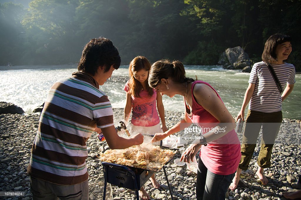 People BBQing by river at national park in Tokyo : Stock Photo