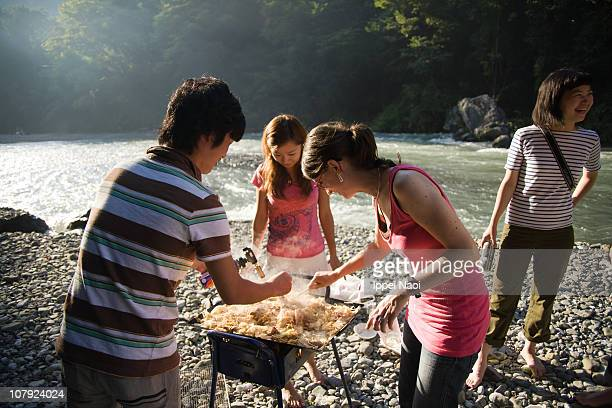 People BBQing by river at national park in Tokyo