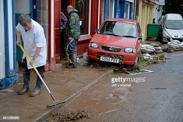 People begin the cleanup following heavy rain which has caused flooding on July 17 2015 in Alyth Scotland Flooding affected properties in the...