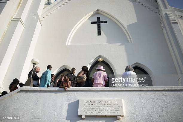 People begin to arrive for a Sunday service at Emanuel AME Church June 21 2015 in Charleston South Carolina Large crowds are expected at Sunday's...