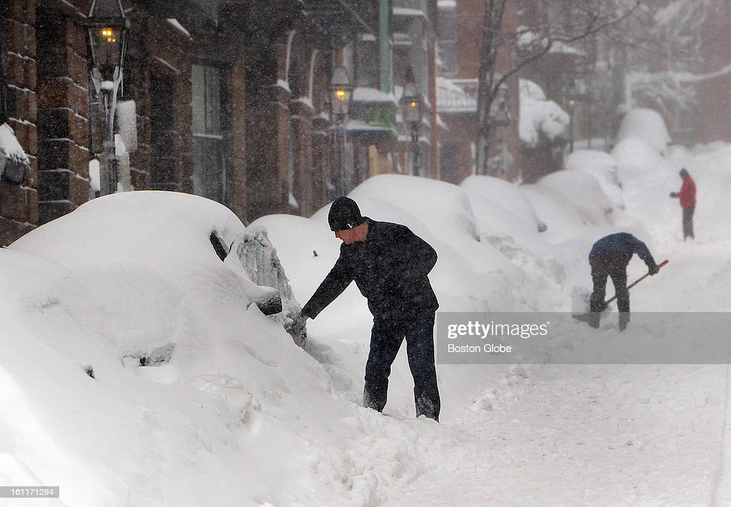 People begin to dig out from the big blizzard. Aengus Mcallister opens the door of his SUV on Walnut Street in Beacon Hill where he lives.