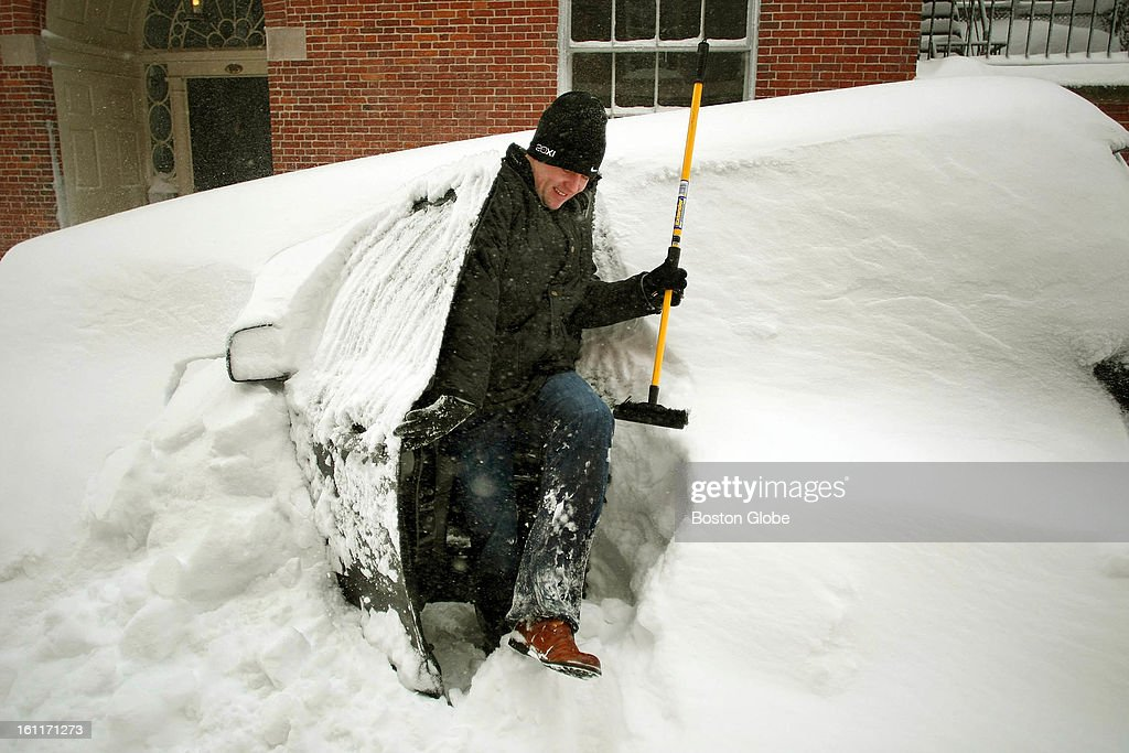 People begin to dig out from the big blizzard. Aengus Mcallister emerges with his snow brush from his snow-covered SUV parked on Walnut Street in Beacon Hill where he lives.