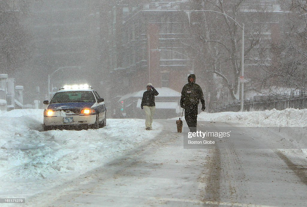 People begin to dig out from the big blizzard. Beacon Street near the State House was still empty of vehicles except for a Boston Police cruiser.