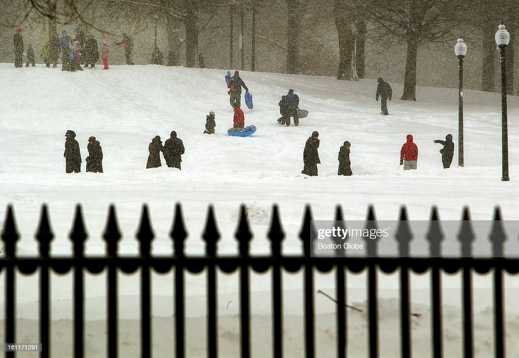 People begin to dig out from the big blizzard. Dozens came to the Boston Common to slide down the hill.