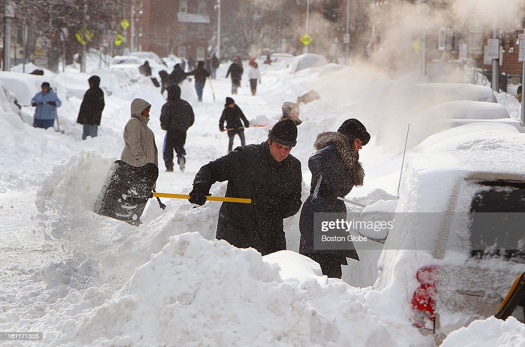 People begin to dig out from the big blizzard. People dig their cars out on Shawmut Avenue in the South End.