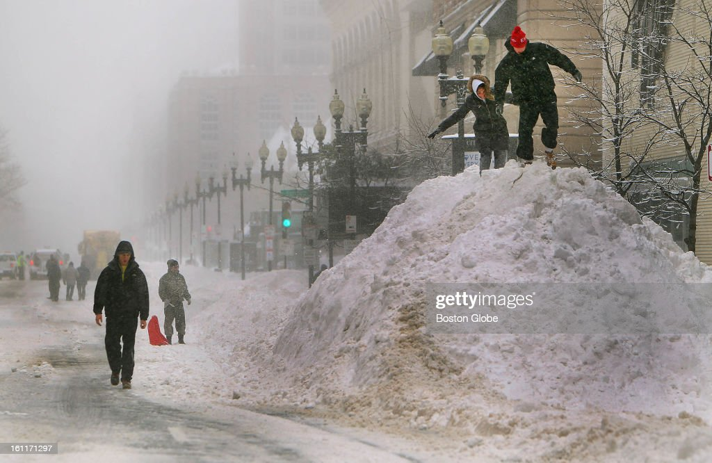 People begin to dig out from the big blizzard. Shaun and Taleen Taylor from Boston climb a huge snow pile on Boylston Street in the Back Bay.