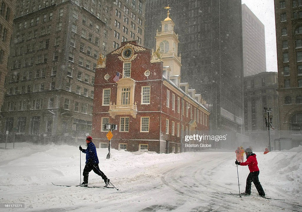 People begin to dig out from the big blizzard. Two people ski along Congress Street past the Old State House.