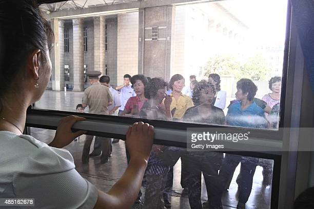 People bid farewell to family in Pyongyang Railway Station on August 24 2015 in Pyongyang North Korea North and South Korea today came to an...