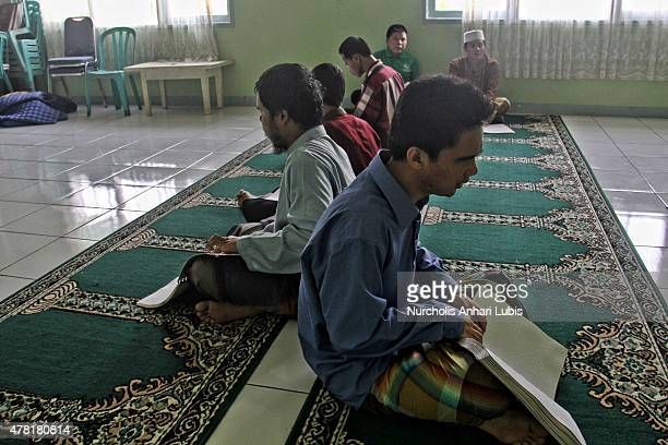 People blind reads a Braille Quran at a blind foundation on June 23 2015 in Tangerang Indonesia Braille Quran is the translation of Quran verses to...