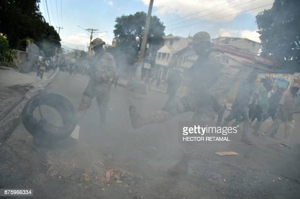 People block a street during a protest against the remobilisation of the army and angry at a senatorial report that investigated the Petrocaribe...