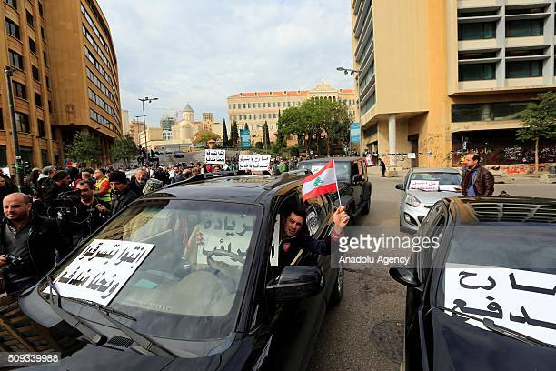 People block the road with their vehicles at Riad Al Solh Square where close to Governmental Palace during an antigovernment demonstration protesting...