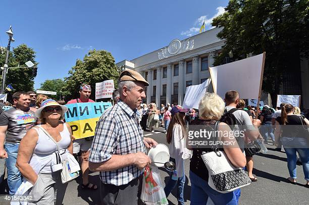 People block traffic as they run continuously at a pedestrian crossing in front of Ukrainian parliament in Kiev during protest action of borrowers of...