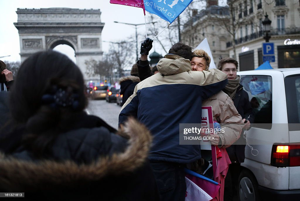 People block traffic in Paris on February 10, 2013 during a demonstration on the Champs Elysees by predomina-ntly French right wing supporters protesting a proposed law to legalise gay marriage and adoption. France's National Assembly overwhelmingly approved a key piece of legislation that will allow homosexual couples to marry and adopt children, to the delight of gay activists.