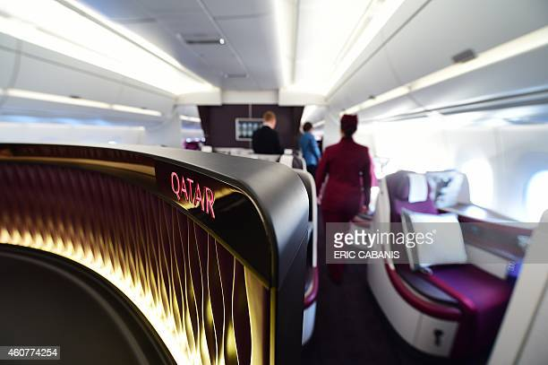 People board the first A350 delivered to Qatar Airways for an hour flight over France on December 22 2014 Airbus delivered its first nextgeneration...