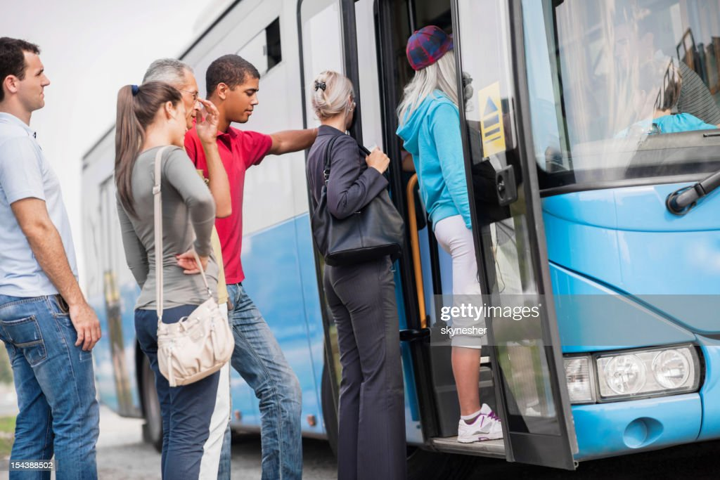 People boarding a bus. : Stock Photo