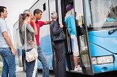 People boarding a bus.