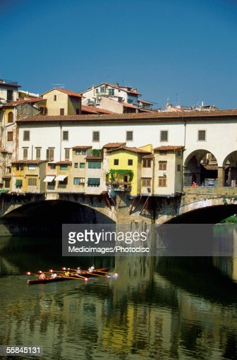 People boating in a river, The Ponte Vecchio Bridge, Arno River, Florence, Italy