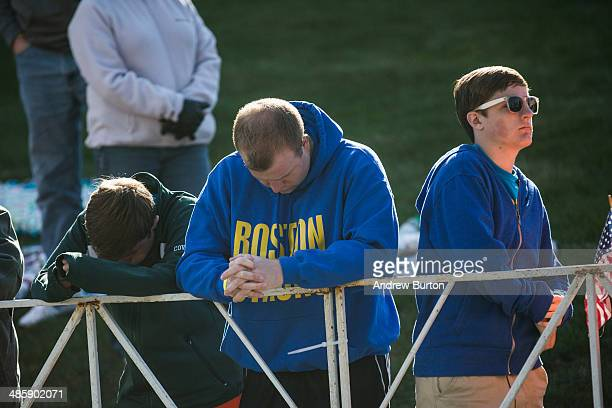 People bow their heads during a moment of silence prior to the start of the Boston Marathon on April 21 2014 in Hopkington Massachusetts Today marks...