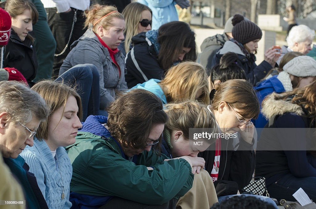People bow their heads during the Washington DC Emancipation Rally, A Prayer rally to End Modern-Day Slavery and Human Trafficking, at the Lincoln Memorial in Washington, D.C., Sunday, January 12, 2013. The rally, which is meant to raise awareness of human trafficking, is being held in conjunction with the Weekend of Prayer to End Slavery and Trafficking.