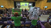 People brandish posters as they protest against fraud during the Bankia Shareholders Extraordinary General meeting in Valencia on April 22 2015 Audit...