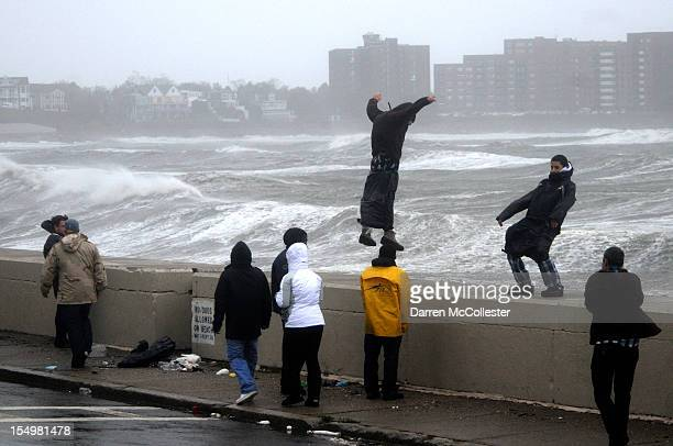 People brave high winds and waves along Winthrop Shore Drive as Hurricane Sandy comes up the coast on October 29 2012 in Winthrop Massachusetts...