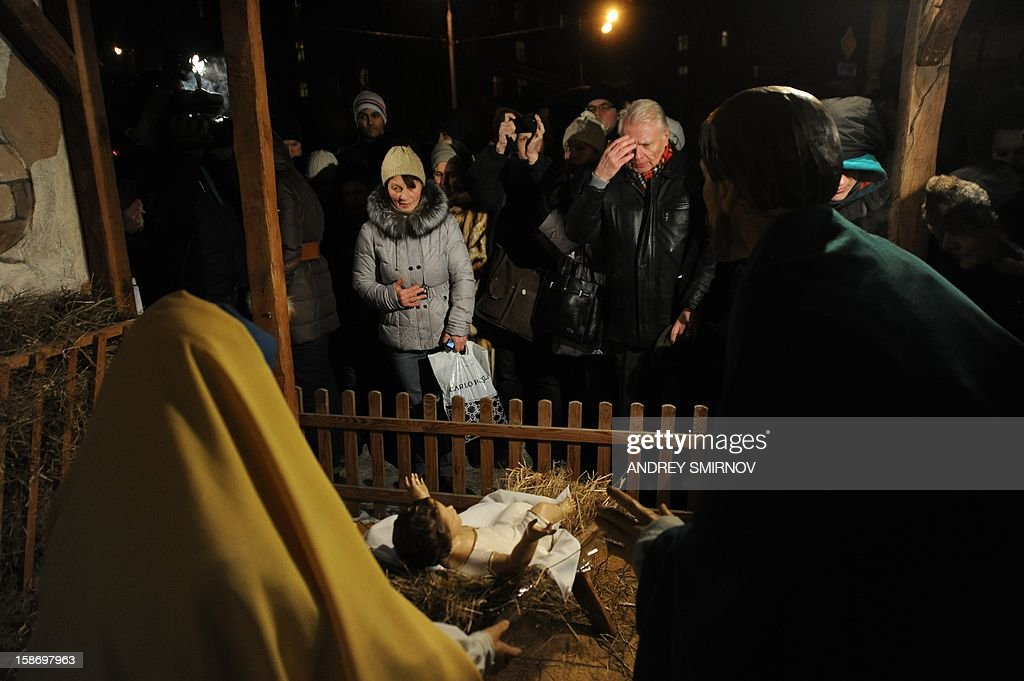 People brave the freezing, - 21 C ( -6 F), outddors as they look at the nativity scene displayed to mark Christmas outside Moscow's Cathedral of the Virgin Mary of Immaculate Conception, on December 24, 2012.