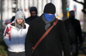 People brave the frigid temperature as they walk near Union Station January 7 2014 in Washington DC A polar vortex that has swept into the east coast...