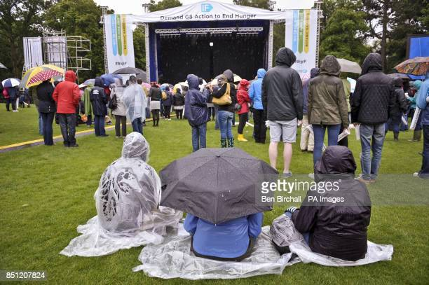 People brave the rain at Belfast Botanic Gardens where the Big IF Belfast concert is taking place ahead of the G8 Summit in Northern Ireland