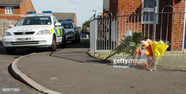 People bring flowers to the junction of Dalton Close and Billinge Street in Blackburn Lancashire where a sixyearold girl was killed in a hitandrun...