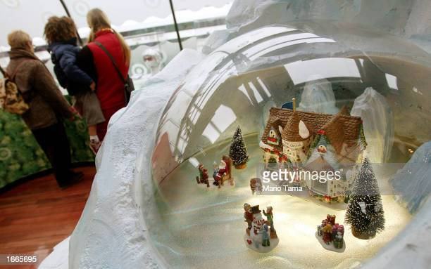 People browse for gifts near a toy castle set for sale on the Target Holiday Boat November 29 2002 in New York City Shoppers hit the stores...