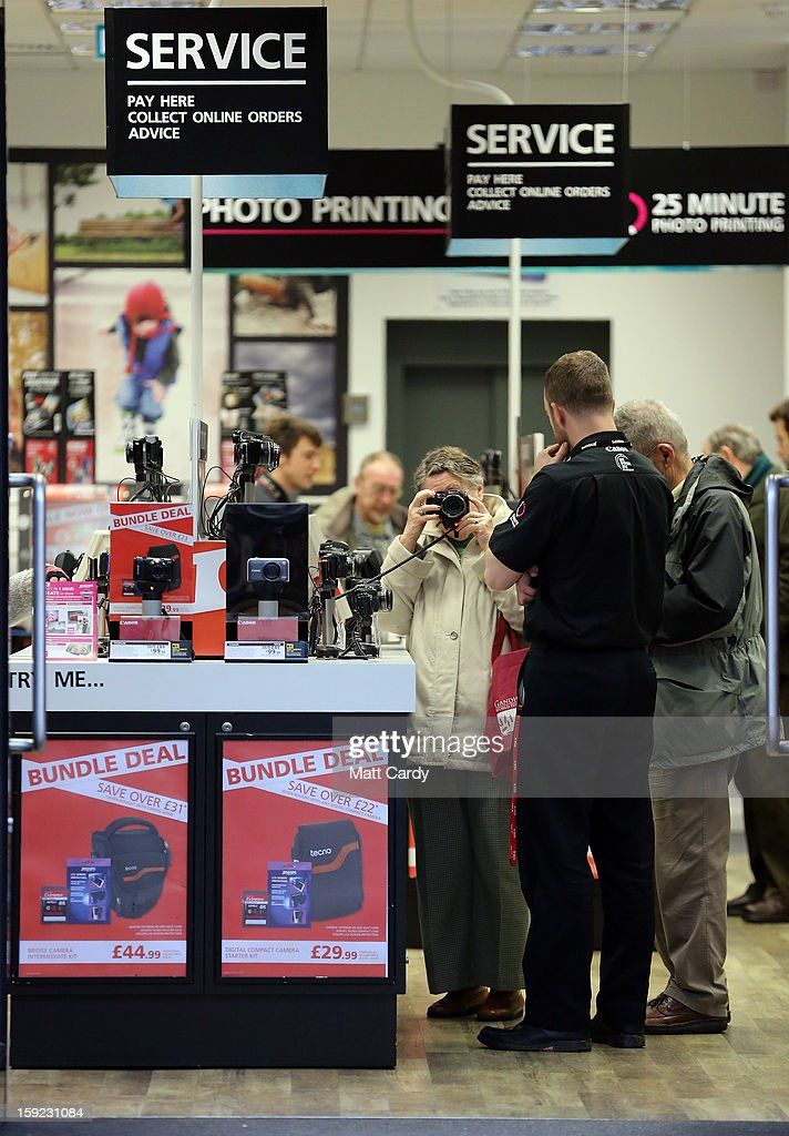 People browse inside a branch of the photographic retailer Jessops on January 10, 2013 in Bath, England. The camera retailer, which was established in the 1930s, has called in administrators, a move which puts more than 2,000 jobs at risk at its 193 stores across the UK. The announcement comes on the day that Marks & Spencer reported worse than expected Christmas clothing sales.
