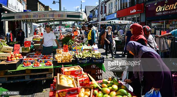 People browse items on sale at stalls in Walthamstow market on August 9 2016 in London England Walthamstow Market in north east London is believed to...