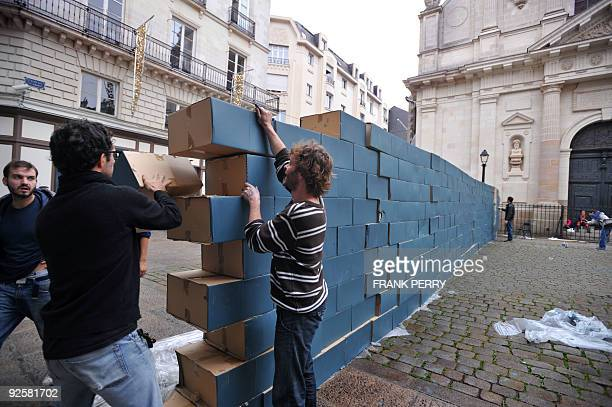 People build a wall made of cardboard bricks on October 31 in Nantes western France The wall will be covered with graffiti and later demolished to...