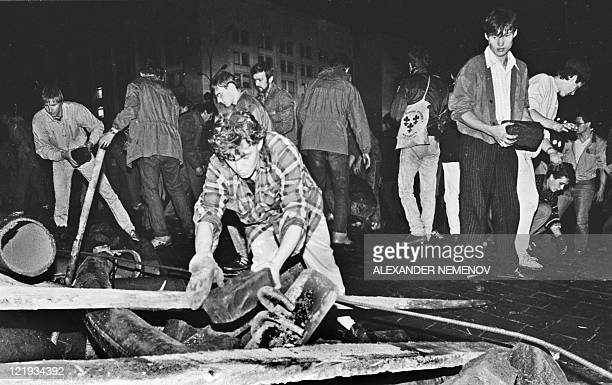 People built up a barricade in front of the Russian White House in central Moscow early on August 20 1991 Russia marks on August 1922 the 20th...